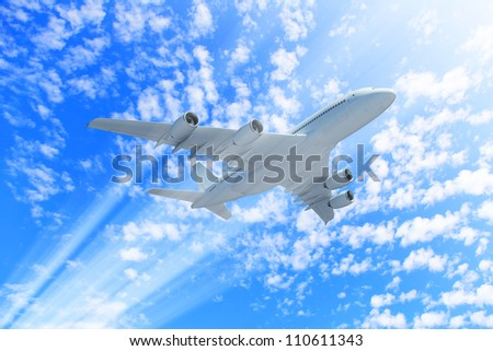 Large passenger airplane flying in the sky - stock photo