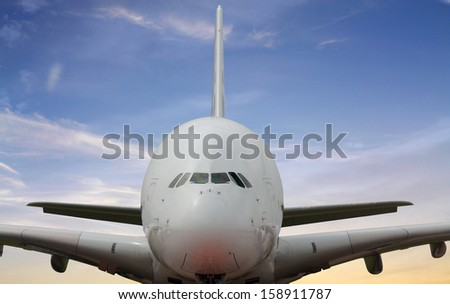 Large passenger jet, front view - stock photo