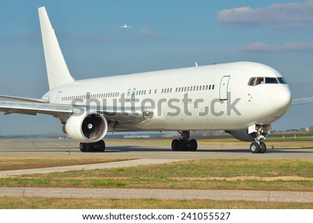 Large passenger jet taxiing to the runway in the airport - stock photo