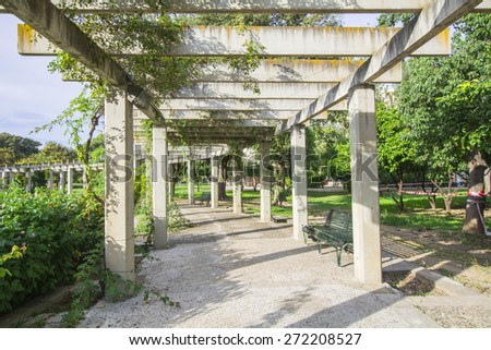 Large pergola with hanging creepers in a park - stock photo