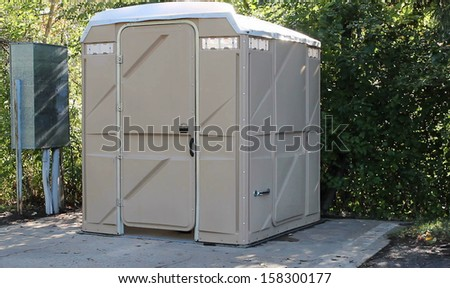 large plastic portable toilet for use by outdoor enthusiasts - stock photo