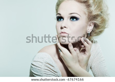 Large portrait fashion woman with hands in faces - stock photo