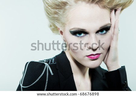 Large portrait of a creative hairstyle and makeup - stock photo