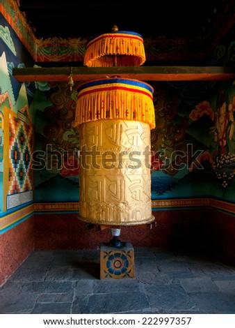 Large prayer wheel for good karma at the Punakha Dzong in Bhutan - stock photo
