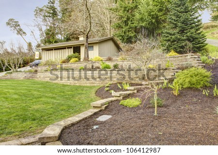 Large property with spring landscape and garage. - stock photo