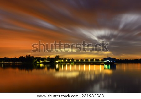 Large pumping stations, reservoirs Tricks with light and clouds flowing. - stock photo