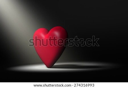 Large, red heart stands forward in a bright spotlight on a dark background. - stock photo