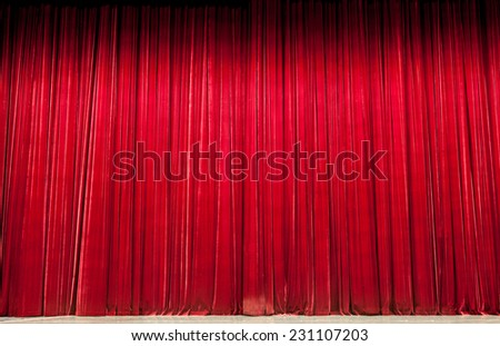 Large red stage curtain with spot lights - stock photo