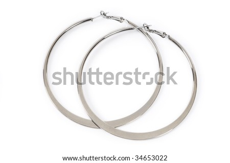 Large ring shaped earrings isolated on white background - stock photo
