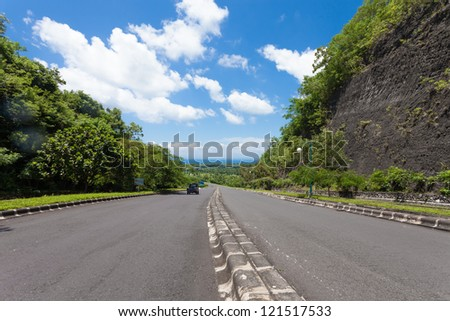 Large road leading to coast in Bali, Indonesia - stock photo