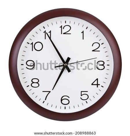 Large round clock shows five minutes to seven - stock photo
