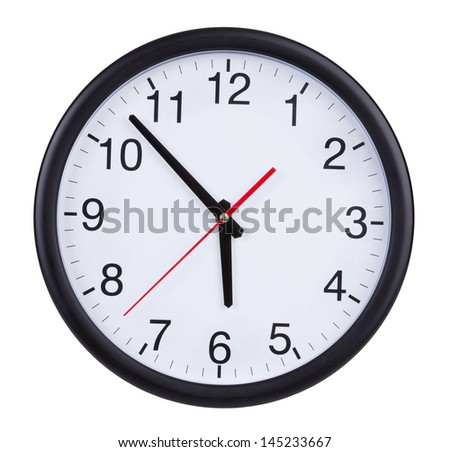 Large round clock shows five to six - stock photo