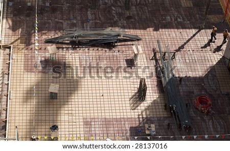 Large scale construction site featuring the foundation of what will be a large skyscraper. - stock photo