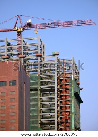 Large Scale Construction -- with crane and scaffolding - stock photo