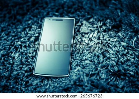 Large screen smartphone with vintage dark color tone tuned - stock photo