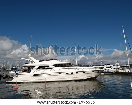 Large sea motorboat in a harbor, view - stock photo
