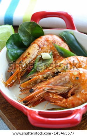 Large seared prawns/shrimp in a chilli, lime and garlic glaze - stock photo