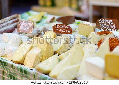 Large selection of cheeses on typical italian farmer market - stock photo