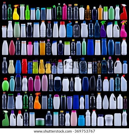 Large set of plastic bottles isolated on black - the waste we produce - stock photo