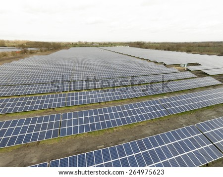 large solar farm in England producing electricity - stock photo