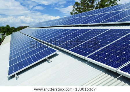 Large solar panel installation on roof - stock photo