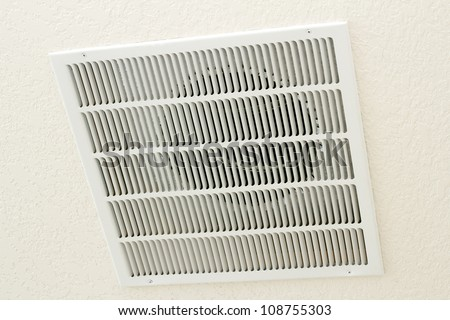 Large square white return air vent located in the ceiling of a home. - stock photo