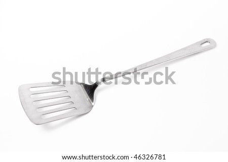 Large Stainless steel Kitchen spatula isolated against white background. - stock photo