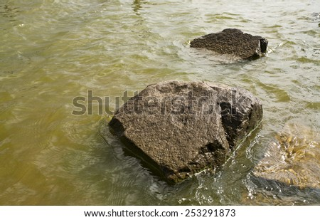 large stone are in water - stock photo