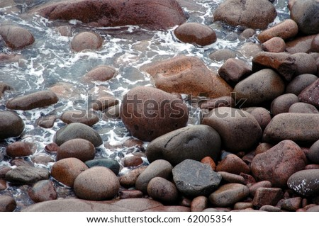 Large Stones-Stones on shore of Atlantic Ocean-Maine - stock photo