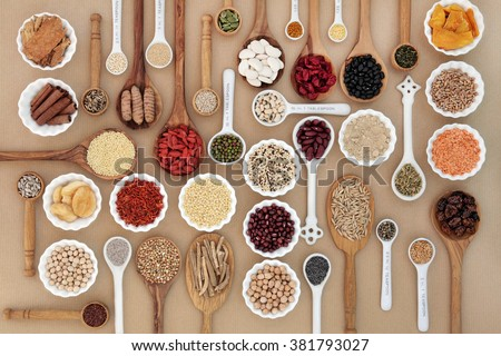 Large superfood sampler for good health in spoons and bowl forming an abstract background. Highly nutritious in antioxidants, vitamins, minerals and dietary fiber. - stock photo