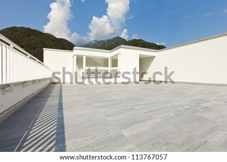 large terrace of a modern white house - stock photo