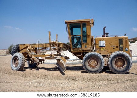 Large tractor working on a new  road - stock photo