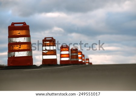 Large traffic cones on highway - stock photo
