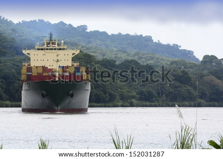 Large transport ship moving across Gatun Lake in the Panama Canal  - stock photo