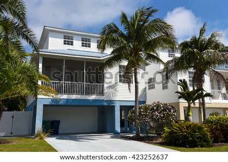 Large Two-Story Beach House with screened in porch - stock photo