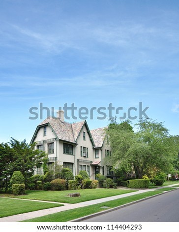 Large Victorian Home in Suburban Neighborhood - stock photo
