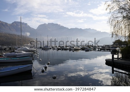 Large view of Annecy lake, marina of Saint Jorioz and mountains, in Savoy, France - stock photo