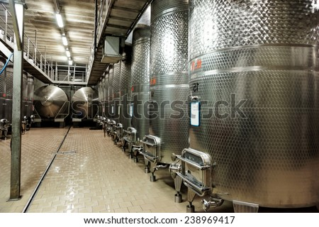 Large volume stainless steel fermenters used to make wine - stock photo