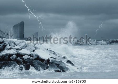 large waves are crashing on the rocks - stock photo