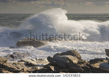 Large waves near Pemaquid Point on the coast of maine. - stock photo