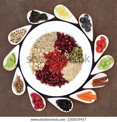 Large weight loss and diet super food selection in white bowls  over lokta paper background. - stock photo