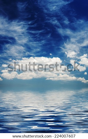 Large white clouds over the boundless sea. natural composition - stock photo