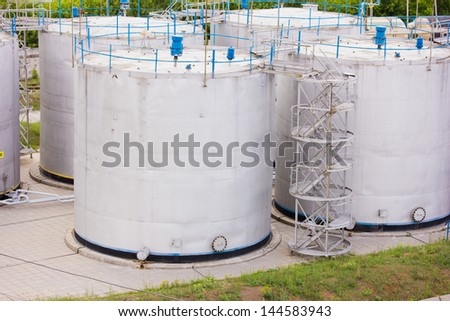 large white tanks for petrol and oil - stock photo