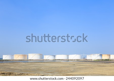 Large white tanks in tank farm for petrol and oil - stock photo