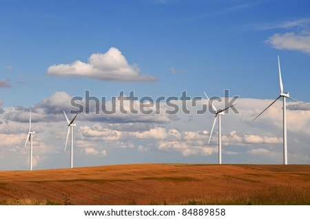 Large wind turbines gathering electricity out of the wind in eastern Colorado, USA - stock photo