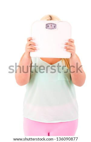 Large woman holding a scale - diet concept - stock photo