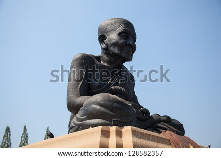 Larger Buddha. The back is covered sky overcast. - stock photo