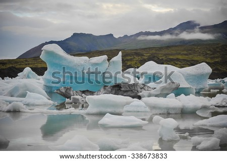 largest glacier in Iceland. icebergs floating in the lake. global warming - stock photo