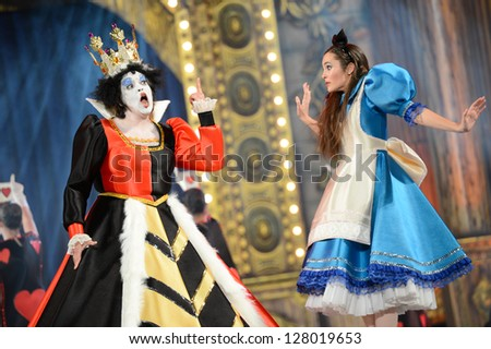 LAS PALMAS, SPAIN -FEBRUARY 10: Unidentified dancers from Canary Islands, playing Alice's Adventures in wonderland, during Junior Queens Gala 's opening show on February 10, 2013 in Las Palmas, Spain. - stock photo
