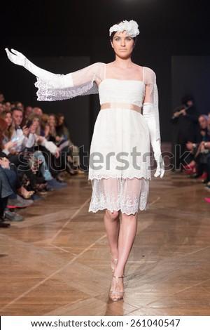 LAS PALMAS, SPAIN - MARCH 12, 2015: A model walks the runway wearing a wedding dress from designer Juan Roga during Gran Canaria Moda Calida 2016 Bridal Collection at Museum Nestor. - stock photo
